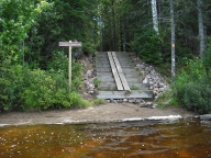 The portage to Crooked Lake is 3,000 feet long, but this canoe slide helps.
