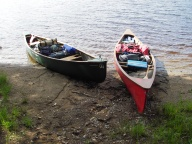 Traveling with loaded boats looking for a campsite.