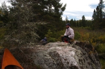 David settles in for lunch on a rock, one of the few dry spots we find along the river.