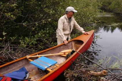 Frtiz Hartley stands on a beaver dam and begins drag-over, a process he'll repeat a dozen times this day.