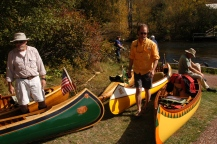Vintage canoes in assorted shapes and colors.