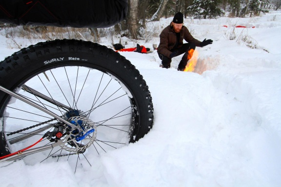 Jason Bratton builds a fire while bike camping in Alaska preparing for the Iditarod Trail Invitational Bike Race. Courtesy photo.