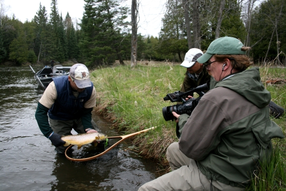 "Film-maker Robert Thompson shoots a segment along the lower AuSable River for ""The Brothers Brown."" Courtesy photo."