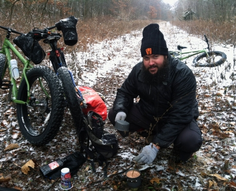 Ted Bentley prepares a hot drink while on an overnight bike camping trip to prepare for the Arrowhead 135 winter bike race in Minnesota in 2014. Courtesy photo.