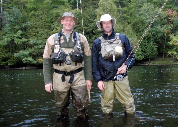 Jon Osborn and Joe VanFaasen, authors of Classic Michigan Flies stop while fishing the Muskegon River. Courtesy photo.