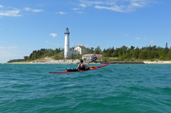 Mequon, Wisconsin paddler Mary Braband explores the waters off South Manitou Island on Lake Michigan. Photo: Ken Braband