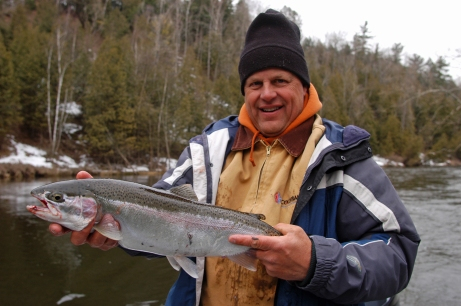 Scott Dixon lands a smaller steelhead.