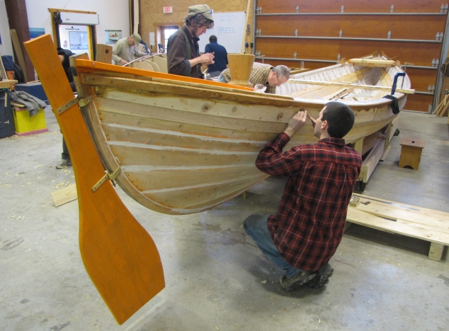 Great Lakes Boat Building School students work on one of seven authentic whaleboat replicas that will launch with the Charles W. Morgan this summer. Photo: Courtesy Great Lakes Boat Building School