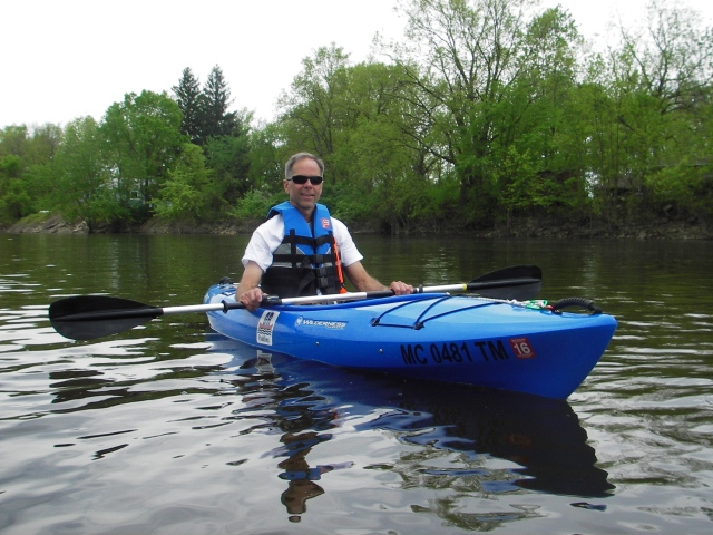 Jeff Neumann is not stranger to canoes and kayaks. His new guided paddling tour business introduces inexperienced paddlers to the sport. Photo: Howard Meyerson