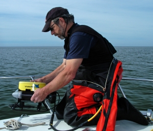 John Hanson prepares to lower the ROV into Lake Michigan to look for the wreck.  Photo: Howard Meyerson