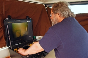 Mark Gleason monitors the progress of a remote sub looking for the shipwreck. Photo: Howard Meyerson