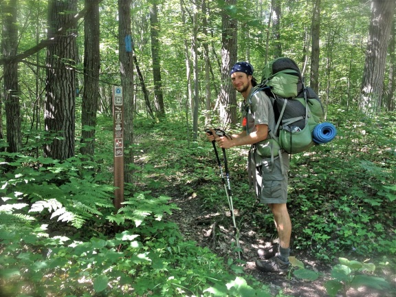 Luke Jordan pauses while hiking the North Country Trail. Photo: Beth Keloneva.