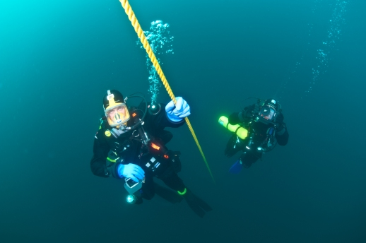 Divers John Achterhoff and John Hanson ascend a mooring line at the end of a dive. Photo: Paul Chase