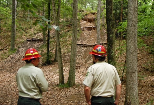 Baldwin district acting ranger, Chris Frederick (left) and trail coordinator, Dave Jaunese (right) look over ORV damage restoration work underway in the Manistee National Forest where illegal hill climbs created erosion. Photo: Howard Meyerson