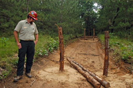 Dave Jaunese looks over work underway to close an illegal road created by rogue ORV riders. Photo: Howard Meyerson