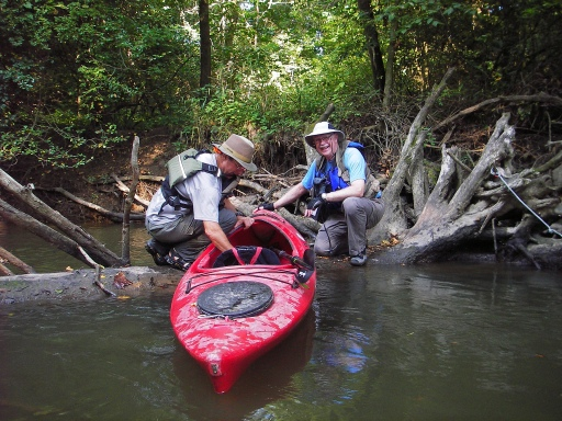 Don Harrell (right) helps John Mitchell drag his kayak over a tree trunk that was exposed by low water levels on the river. Photo: Howard Meyerson