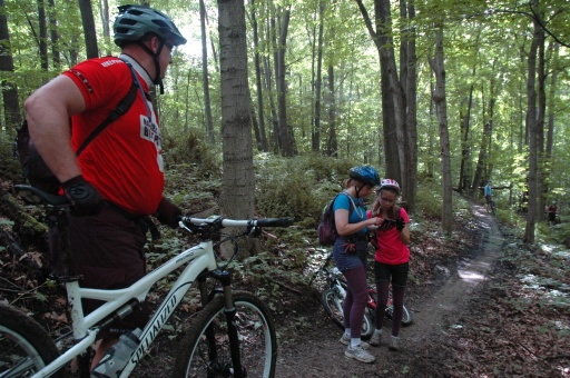 Jeremy Verbeke assisting riders with directions at River Bends Park. Photo: Clinton River Area Mountain Bike Association.
