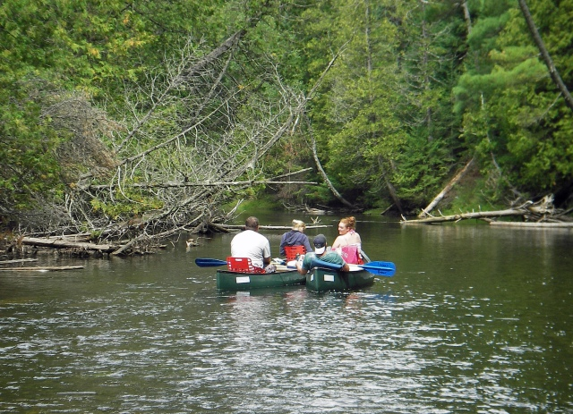 A group enjoys the four to five hour float down the AuSable River South Branch. Photo: Howard Meyerson