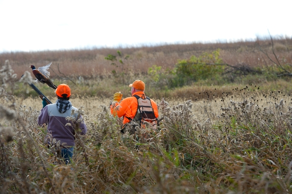 Alyssa Wethington gets some coaching from  and Scott Brosier.  Photo: Dave Kenyon, Michigan DNR