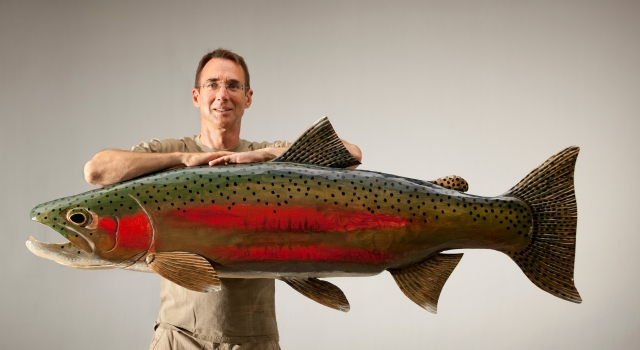 Bob Batchik created this giant steelhead carving as a commissioned work for musician Huey Lewis. The wood fish hangs over the front door of  the musician's California studeo. Photo: Courtesy of Bob Batchik.