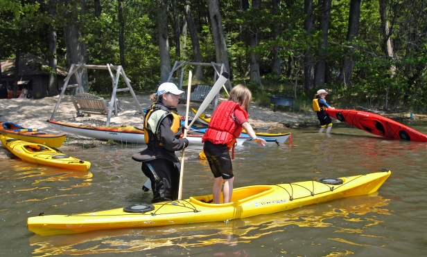 Children learn  balance during a class for kids at the WMCKA Sea Kayaking Symposium. Photo: Howard Meyerson