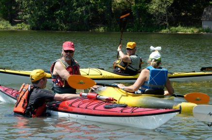 Instructor Michael Gray works the paddlers learning how to roll. Photo: Howard Meyerson