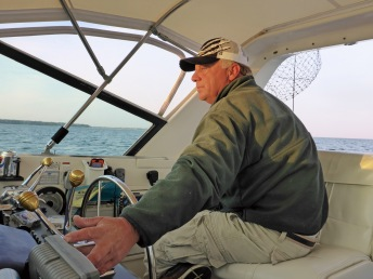 Captain Russ Clark steers his boat, Sea Hawk, into prime fishing waters  just after sunrise. Photo: Howard Meyerson