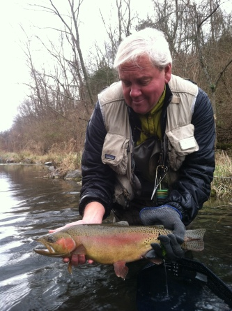 Matt Supinski holds up a rainbow trout caught on Big Spring Creek in Pennsylvania. Photo by:  Jay Nichols