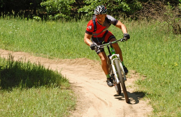 An area rider enjoys the 9-mile trail at Kent County's Luton Park, built by West Michigan  Mountain Biking Alliance members. Photo: Howard Meyerson