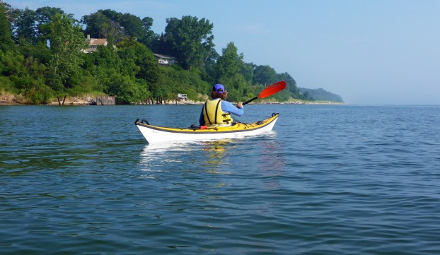 A paddler enjoys exploring the sandy Lake Michigan shoreline by kayak, part of what will become the Lake Michigan Water Trail. Photo: Howard Meyerson.