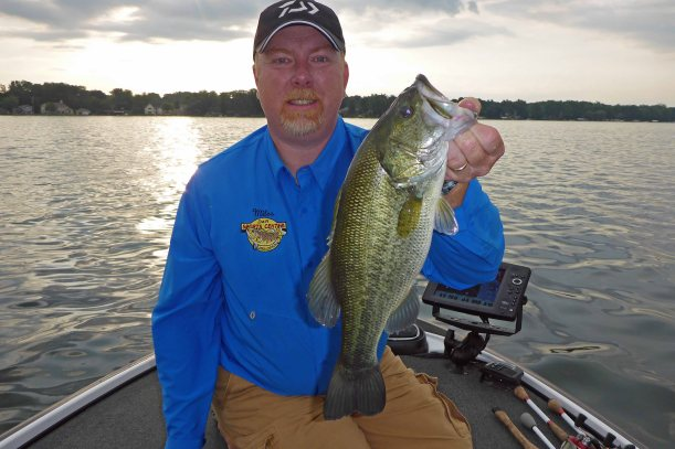 Miles Hanley holds up a 2.5 pound largemouth bass that he landed soon after getting out. Photo: Howard Meyerson