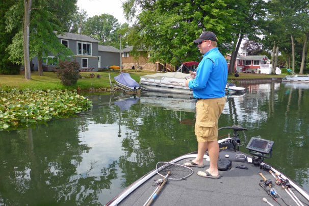 Miles Hanley, the 1998 Michigan State Bass Champion works shoreline structures and vegetation for bass. Photo: Howard Meyerson