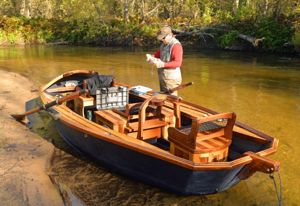 Phil Croff's cedar and walnut drift boats provide a stable platform to fish from on the swift northern Michigan rivers where he guides anglers. Photo: Howard Meyerson