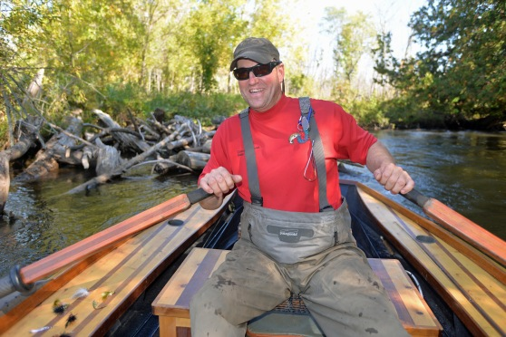Phil Croff enjoys rowing his boats on the swifter, smaller northern Michigan streams. Photo: Howard Meyerson