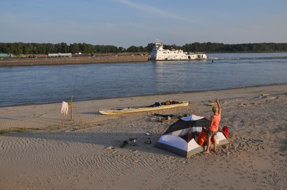 Day 48: While camped on the banks just south of Carutherville, MO, the crew of the upriver-bound Amy Francis blow the ship's horn in greeting and come out and wave. Linda De Kock waves back. Photo: Gary De DeKock.