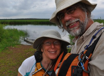 Day 7 near Grand Rapids, MN, the De Kocks shoot a  selfie with the narrow river waters behind them. Photo: Gary De Kock.