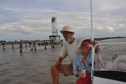 Returning upstream on the river guide's boat, the DeKock's smile and enjoy their first beer in 70 days as they pass the red over green day marker, a coast guard navigation aid marking the channel leading to the Gulf of Mexico, just upstream from the Mile Zero  marker. Photo: Alisun De Kock.