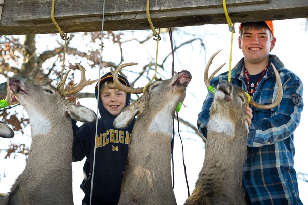 Pictured are 13-year-old Henry Lerrett and Zach Parrett, 16, standing proudly with nice healthy racked bucks at their camp in Menominee County last deer season. (Courtesy | David Kenyon, Michigan DNR)