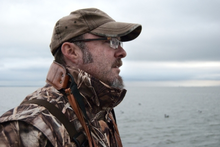 Hank Shaw scans for diving ducks while hunting. Photo: Holly Heyser.