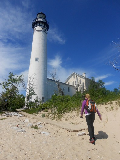 A hiker passing the South Manitou Island Lighthouse, part of Sleeping Bear Dunes National Lakeshore. Photo: Jim DuFresne