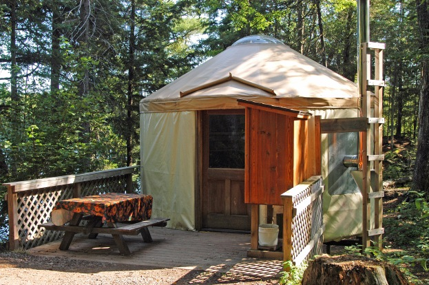 The 16-foot-diameter yurt at Craig Lake State Park sleeps four people and is equipped with bunk beds, mattresses, a wood stove, axe, bow saw, and cooking and eating utensils. Running water and electricity are not provided, but an outhouse is located nearby. Photo Howard Meyerson.