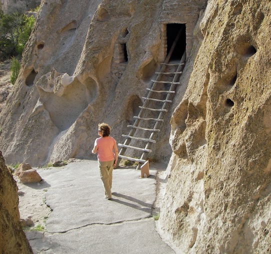 A visitor explores the ancient cliff dwellings at Bandelier National Monument in New Mexico. Photo: Howard Meyerson