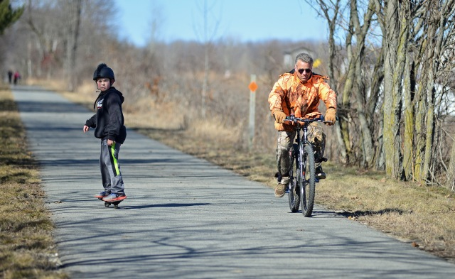 Cyclists and skateboarders regularly use the paved portions of the White Pine Trail. Critics suggest skateboarders and others will not be able to use the segments that will be surfaced with crushed limestone. Photo: Howard Meyerson.