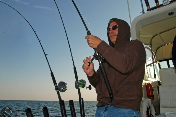 Anglers can anticipate catching salmon again this summer, though the Lake Michigan alewife population remains at an all-time low. Photo: Howard Meyerson.