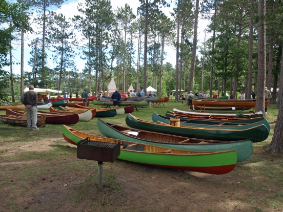 An assortment of wooden canoes like these shown at the WCHA Regional Assembly in Marquette in 2013 will be on display this year. Photo courtesy of WCHA