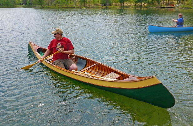 WCHA member Dave McDaniel, of Oscoda (foreground), and WCHA president, Ken Kelly, of Grand Rapids, enjoy a paddle in wood canoes in early summer. Photo:  Howard Meyerson
